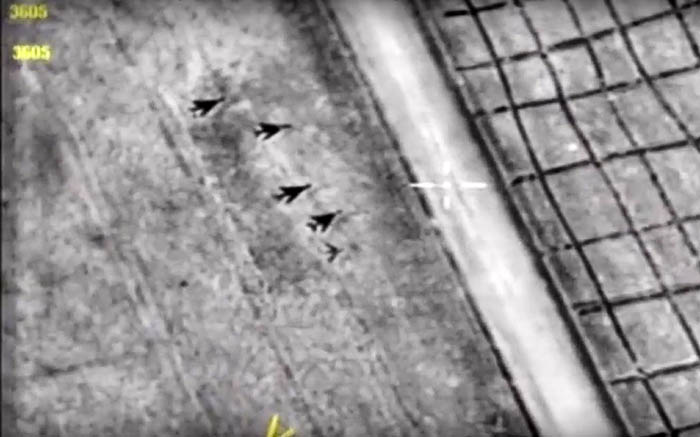 A handout grab image from a video made available by the Russian Defence Ministry's press service on the official website of the Russian Defence Ministry shows aircraft at the Shayrat airbase after it was hit by US strike on 7 April 2017. Picture: Russian Defence Ministry/AFP.