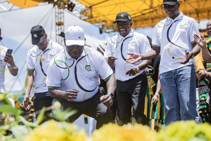 President Cyril Ramaphosa, joined by other senior ANC members, dance during the party's birthday celebrations. Picture: Sethembiso Zulu/EWN.