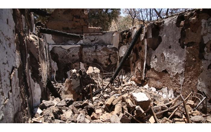 The inside of a popular tourist stop, Lekkerbekkie, that burnt down during the fire. Picture: Bertram Malgas/EWN
