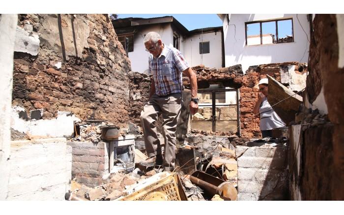 Johannes Salomo walks through what used to be his kitchen. Picture: Bertram Malgas/EWN