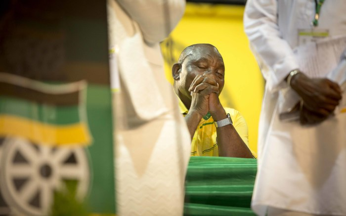 Cyril Rampaphosa closes his eyes as religious leaders offer prayers to their respective gods at the start of the ANC's 54th national confere