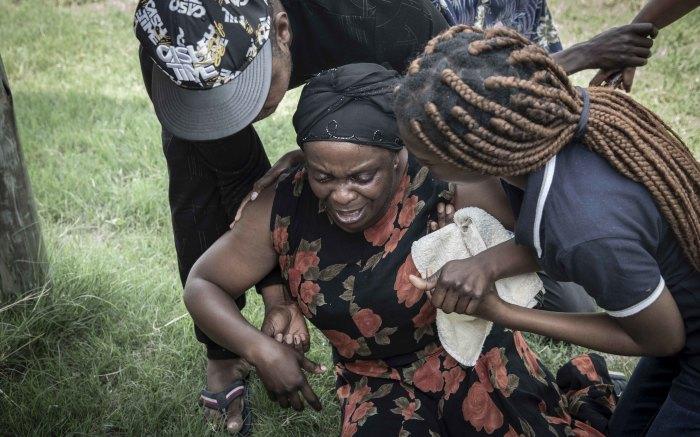 Enock's mother, Antionette Mpianzi, breaks down.