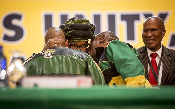 Winnie Madikizela Mandela embraces President Jacob Zuma and Deputy President Cyril Ramphosa at the start of the ANC's 54th national conferen