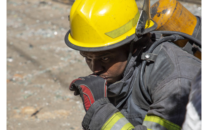 A firefighter fights back tears as his fallen colleagues are remembered.