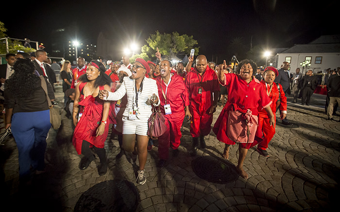 After being thrown out of Parliament, EFF members sang and marched around the Parliamentary grounds. Picture: Thomas Holder/EWN