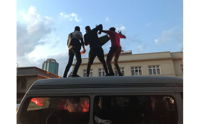 A few men dance on top of taxi's as they celebrate Mugabe's resignation. Picture: Masechaba Sefularo/EWN.