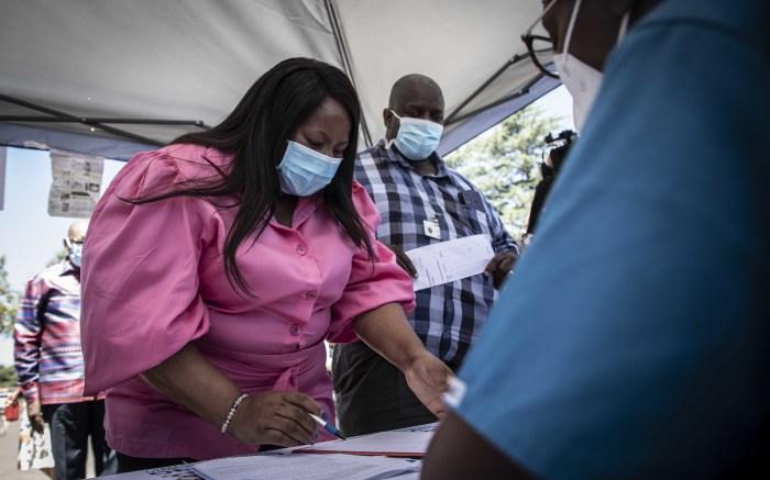 Gauteng Health MEC Nomathemba Mokgethi registering at the vaccination centre at Chris Baragwanath Hospital. Picture: Abigail Javier/EWN