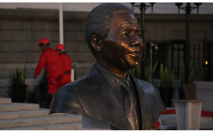 EFF members are seen making their way into Parliament behind the bust of former president Nelson Mandela.