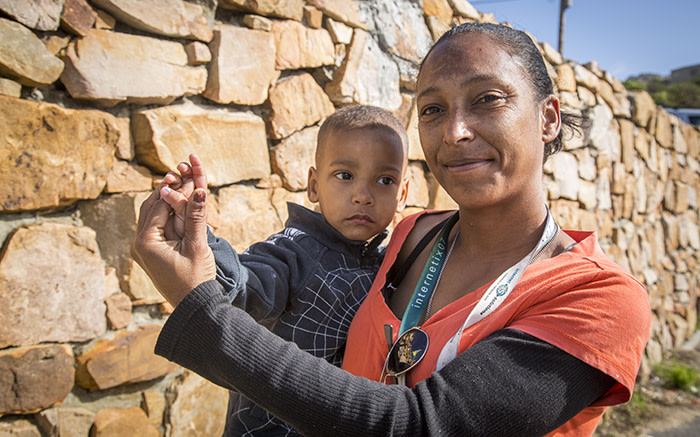 Hangberg resident Bronwyn Smidt and her son show off their marked thumbs after she voted on 3 August 2016. Picture: Aletta Harrison/EWN.