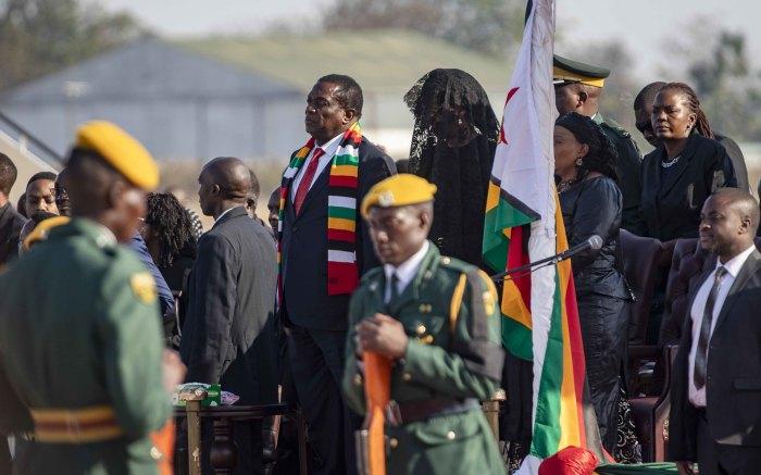 President Emmerson Mnangagwa stands alongside widow Grace Mugabe at the airport when receiving Robert Mugabe's body.