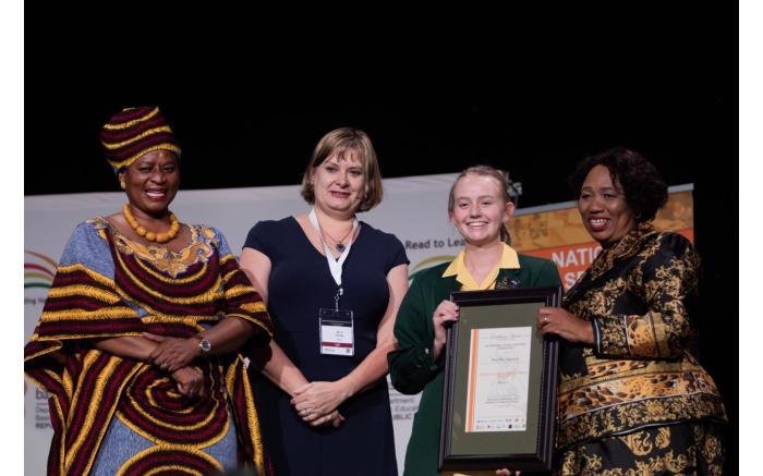 Top achiever Madeleine Dippenaar with Reginah Mhaule, Debbie Schafer and Angie Motshekga.