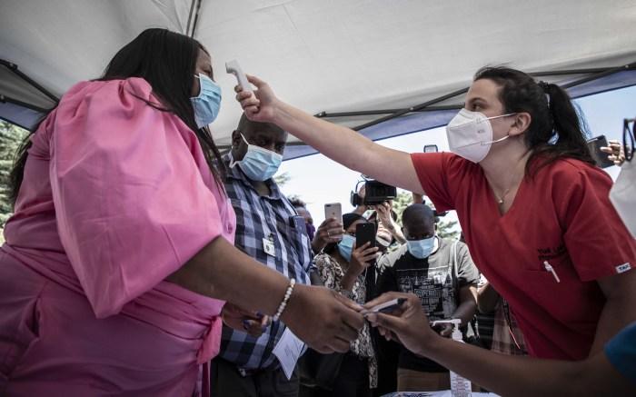 Gauteng Health MEC Nomathemba Mokgethi's temperature is taken ahead of being vaccinated. Picture: Abigail Javier/Eyewitness News