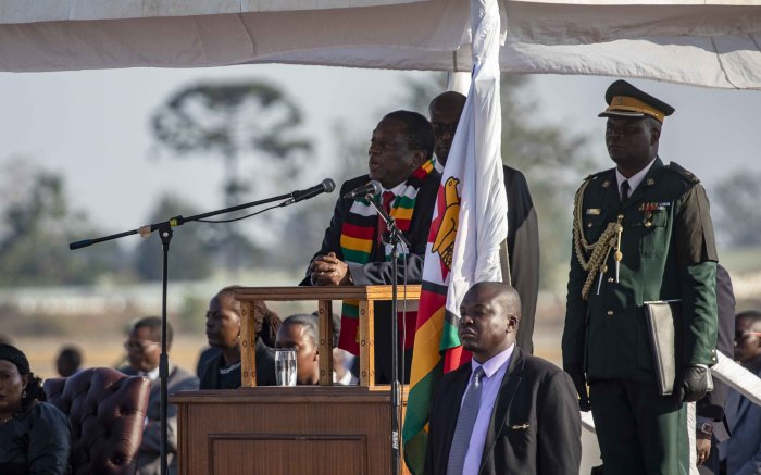 President Emmerson Mnangagwa addresses crowds gathered at the airport for the arrival of the late Robert Mugabe.