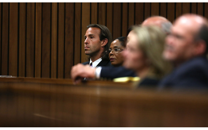 Darren Fresco (L) is seen during judgment in the murder trial of Oscar Pistorius at the High Court in Pretoria on Friday, 12 September 2014. Picture: Pool.