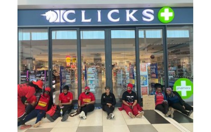EFF Treasurer-General Omphile Maotwe with EFF members outside the Clicks in Menlyn Mall, Tshwane. Picture: EFF @EFFSouthAfrica