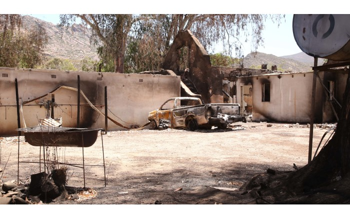 The burnt out shell of a bakkie is all that remains after a fire swept through Wupperthal. Picture: Bertram Malgas/EWN