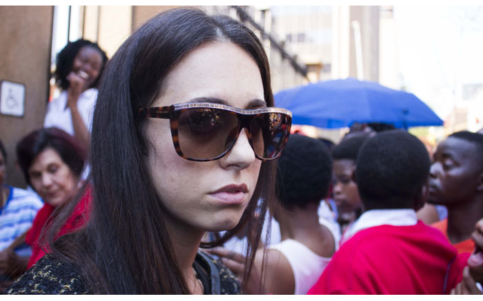 Gina Myers leaves the High Court in Pretoria after the reading of judgment in the Oscar Pistorius murder trial on 12 September 2014. Picture: Christa Eybers/EWN.