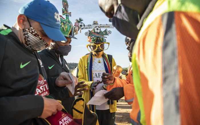 Fans having their vaccine card, ID document and ticket checked outside the FNB Stadium.  Picture: Abigail Javier/EWN