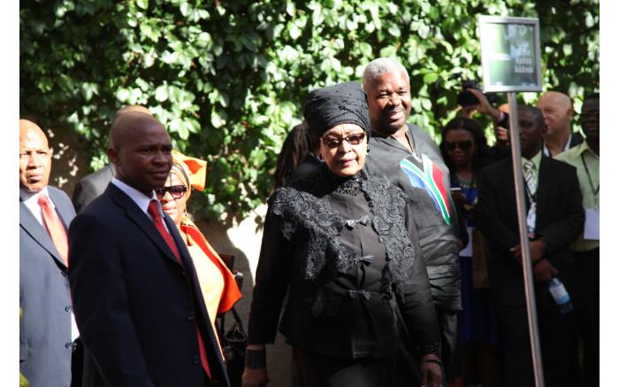 A sombre-looking Winnie Madikizela-Mandela arrived wearing black.