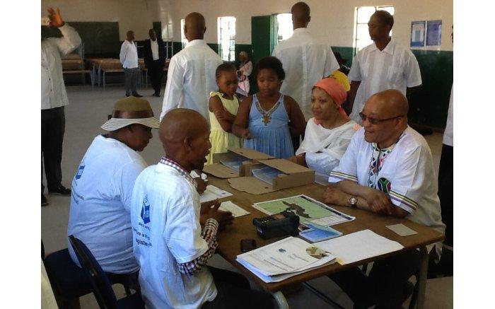 President Jacob Zuma and his wife Thobeka Madiba register to vote at the Ntolwane Primary school in Nkandla.