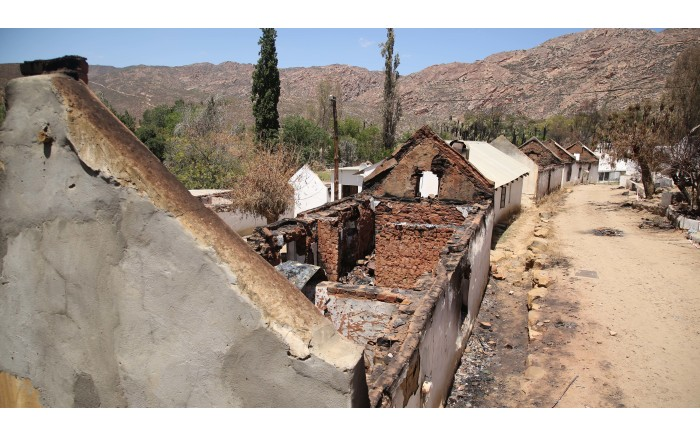 A row of burnt out houses in Wupperthal. Picture: Bertram Malgas/EWN