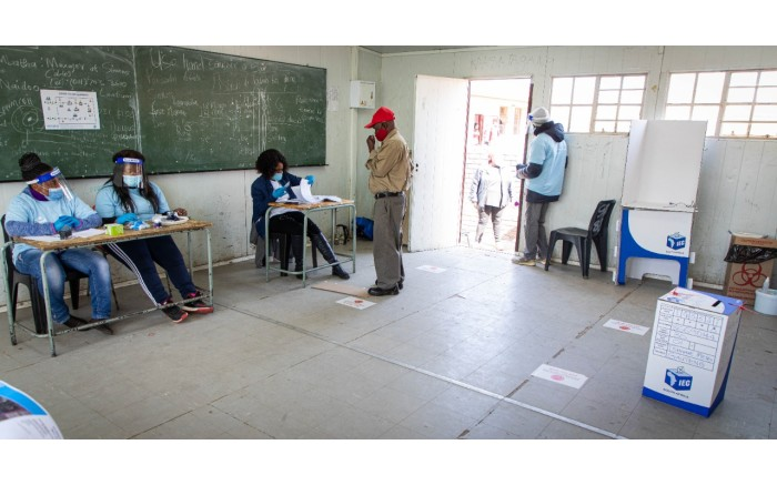 Voters being assessed before they can cast their votes.