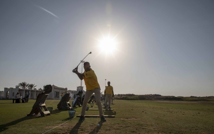 South African golfers on the Yas Links driving range before they compete for divisioning. Picture: Thomas Holder/EWN
