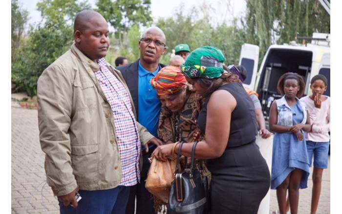 A mourner arrives to pay her respects outside the house of Winnie Madikizela-Mandela.