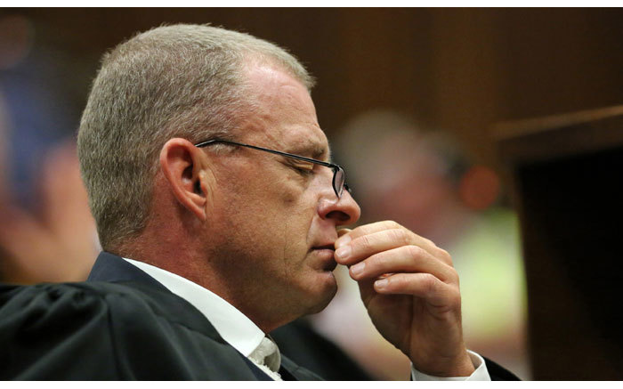 Prosecutor Gerrie Nel reacts as judgment is handed down in the murder trial of Oscar Pistorius at the High Court in Pretoria on 12 September 2014. Picture: Pool.