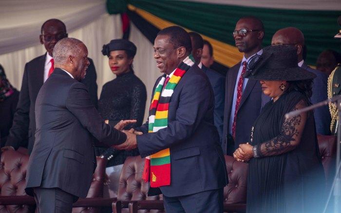 Former SA President Thabo Mbeki greets Zimbabwean President Emmerson Mnangangwa.