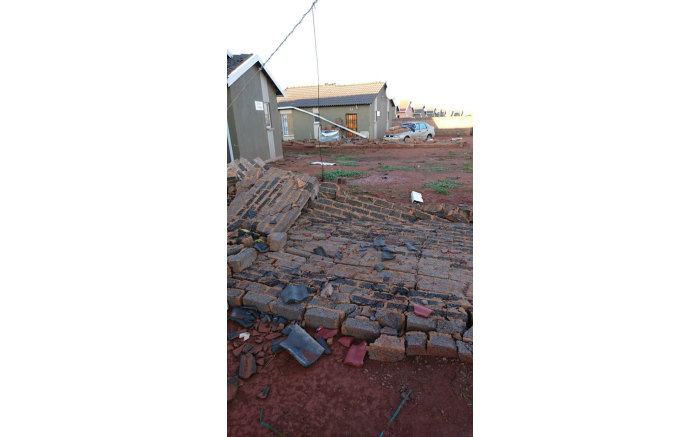 A collapsed boundary wall in Protea, Soweto following a storm in the area on 30 December 2017. Picture: Leeto Khoza/EWN