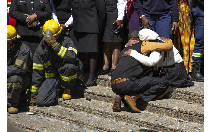 Family members and firefighters honour their loved ones and colleagues.