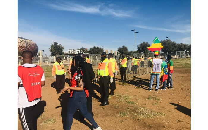 Excited fans outside the FNB Stadium for Bafana Bafana vs Ethiopia in a 2022 FIFA World Cup qualifier. Picture: Tholakele Mnganga/EWN
