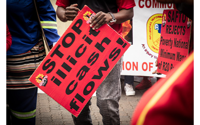 Carrying placards directed at government, Saftu and Cosatu members marched through the Johannesburg CBD. Picture: Xanderleigh Dookey/EWN