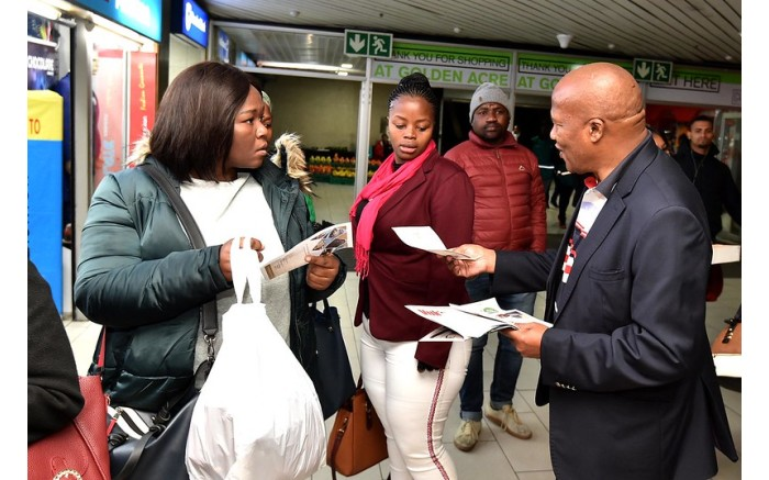 Minister Jackson Mthembu hands out pamphlets ahead of Sona 2019. Picture: Government ZA