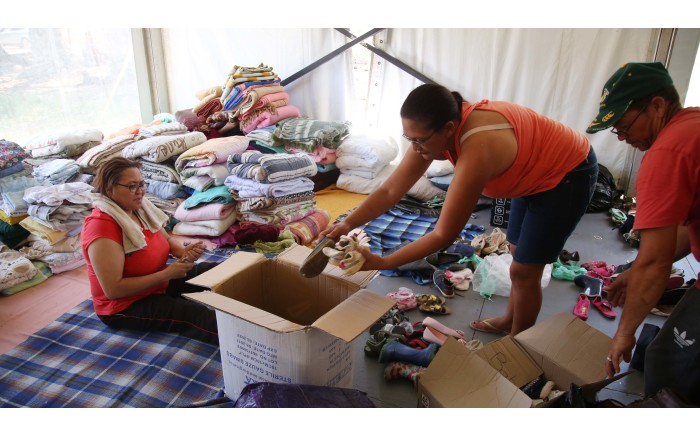 Wupperthal community members collect clothes and shoes at the donations tent in town. Picture: Bertram Malgas/EWN