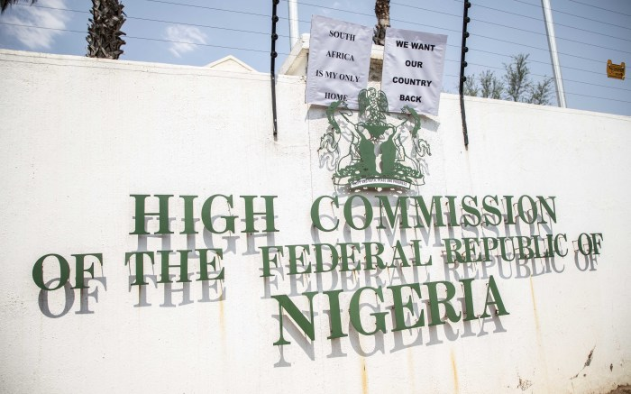 Protesters hung their placards on the wall of the Nigerian embassy.