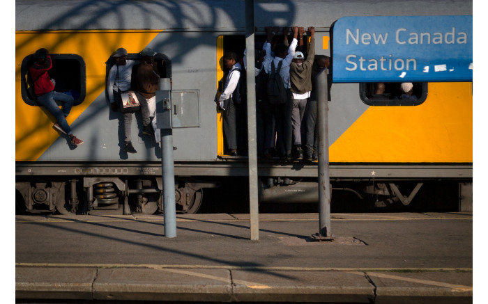 Members of the public travel on an overcrowded train at the New Canada station in Johannesburg,  Picture: Sethembiso Zulu/EWN