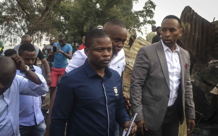 Pastor Shepherd Bushiri is taken around Alexandra following a fire burnt more than 100 shacks to the ground. Photo: Ahmed Kajee/EWN
