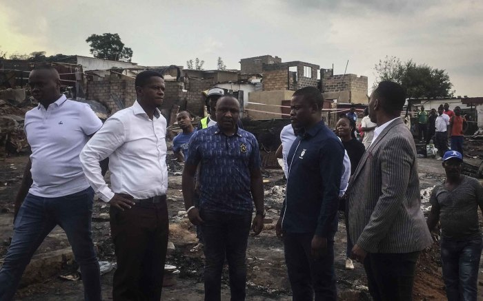 Bushiri and his entourage in Alexandra following a fire burnt more than 100 shacks to the ground. Photo: Ahmed Kajee/EWN