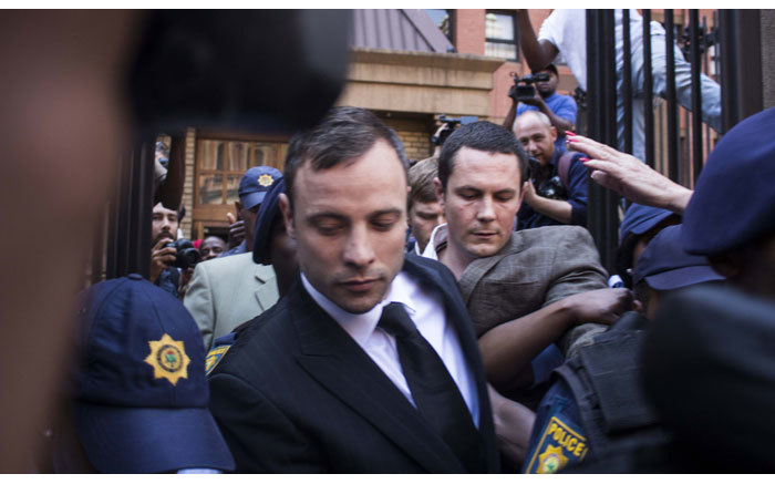 Oscar Pistorius leaves the Hight Court in Pretoria after the reading of judgment in his murder trial on 12 September 2014. Picture: Christa Eybers/EWN.