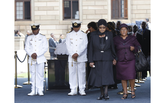 Winnie Mandela leaves after viewing the coffin of former South African President Nelson Mandela lying in state on December 11, 2013,