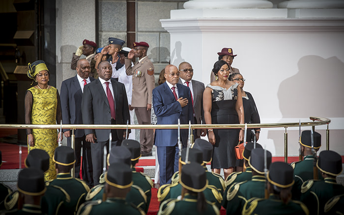 President Jacob Zuma and his Deputy Cyril Ramaphosa stand at attention, Zuma with hand over heart, while the National Anthem plays. Picture: Thomas Holder/EWN