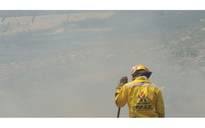 A firefighter looks on after several fires broke out in the Western Cape. Picture: @wo_fire