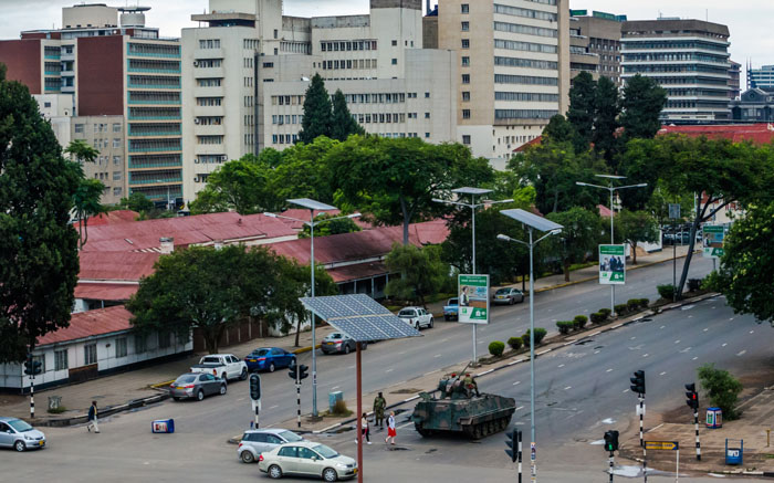 An armoured personnel carrier at an intersection as Zimbabwean soldiers regulate traffic in Harare on 15 November 2017. Picture: AFP.