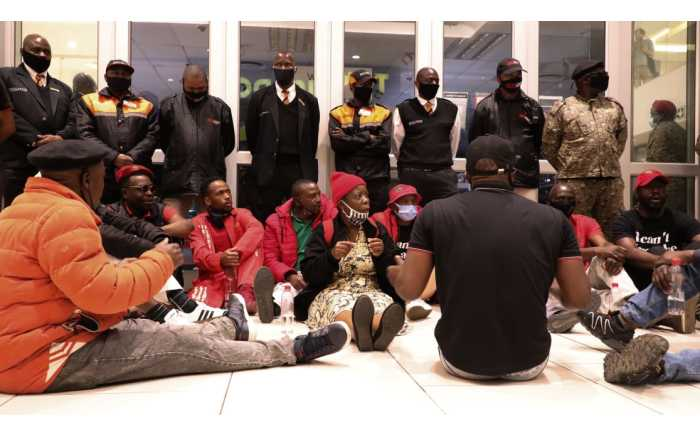 EFF members gather outside Clicks store at Sandton City in Johannesburg. Picture: Kayleen Morgan/EWN.