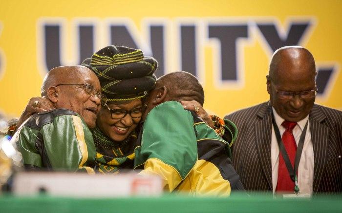 Winnie Madikizela Mandela embraces President Jacob Zuma and Deputy President Cyril Ramphosa at the ANC's 54th national conference.
