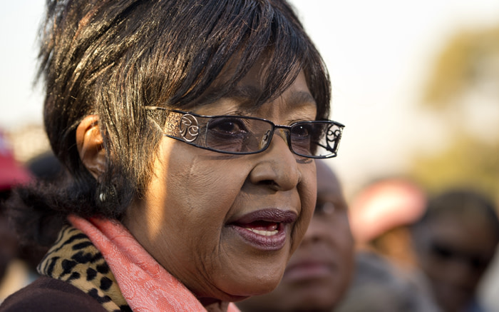 Winnie Mandela Madikizela, speaks to the media outside their first family home in Soweto.