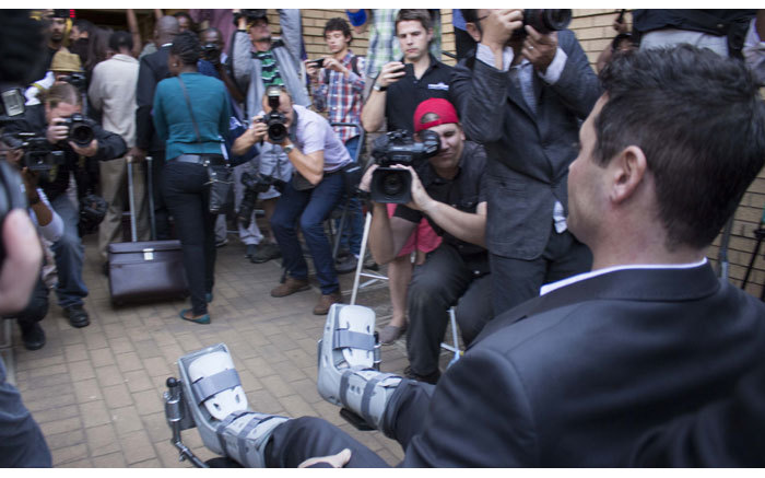 Carl Pistorius arrives in a wheelchair to attend judgment in his brother Oscar's murder trial. Picture: Christa Eybers/EWN.