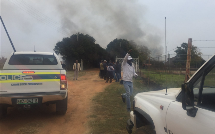 Angry community members set fire to a house after the Coligny murder accused were granted bail. Picture: Masa Kekana/EWN